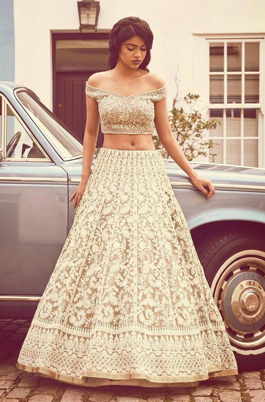 Demanding Net Fabric Chiku Color Party wear Lehenga choli