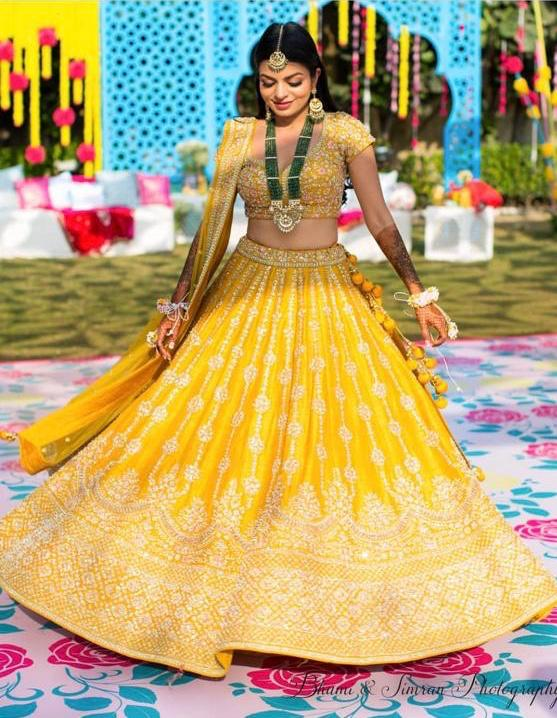 Amazing Yellow color Tapeta Silk Wedding Lehenga Choli