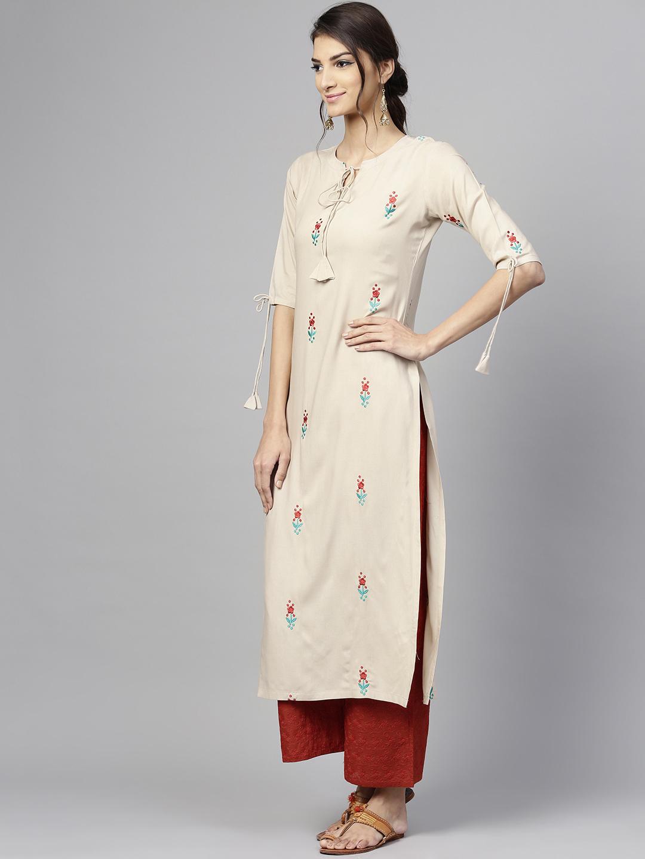 Women's New Stylish Designer Cream Rayon Kurtis With Plazzo