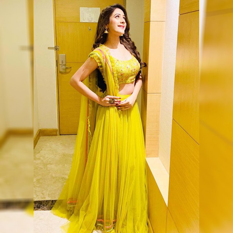 Blissful Yellow Color Designer Net LehengaCholi