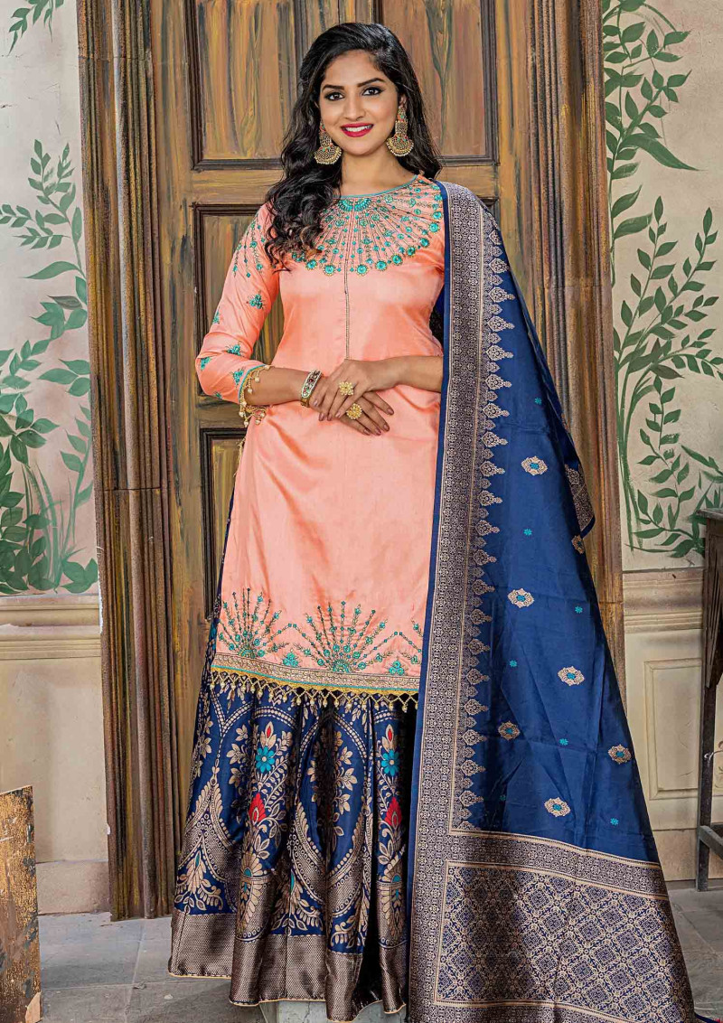Exotic Ruby Fabric Embroidery Peach Color  Party Wear Sharara Suit