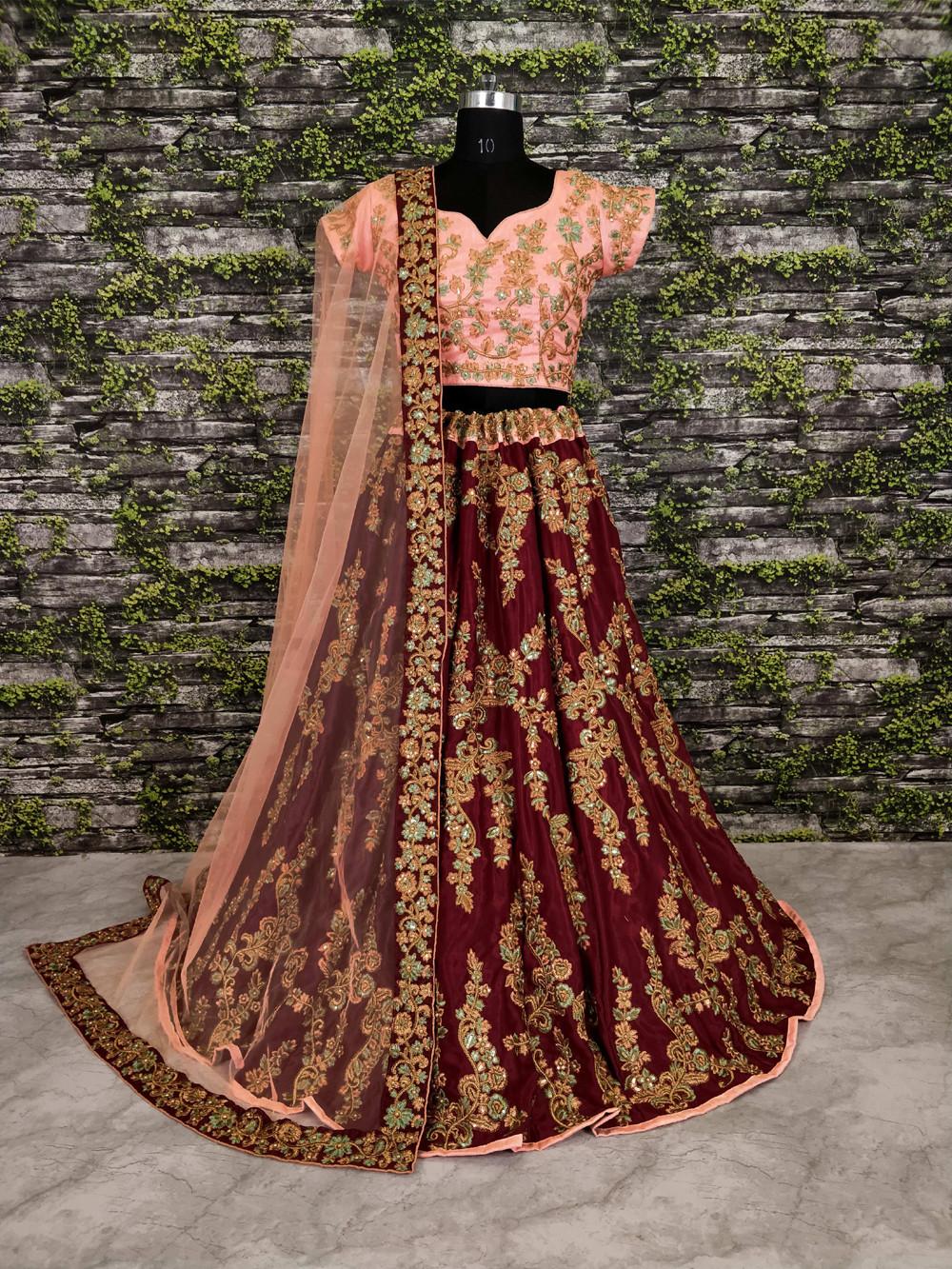 Presenting Maroon Color Velvet Wedding Wear Lehenga Choli