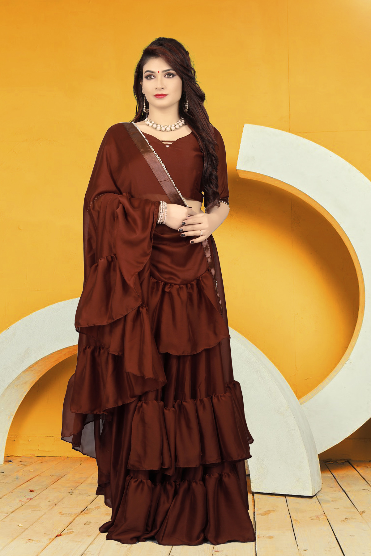 Ruffle Saree Design In Brown Color