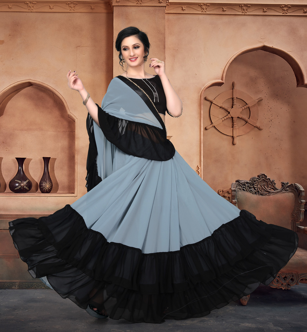 Party Wear Grey And Black Georgette Ruffle Saree With Beautiful Blouse