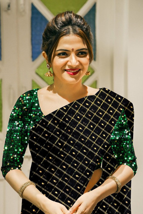 Green Heavy Blouse With Black Saree