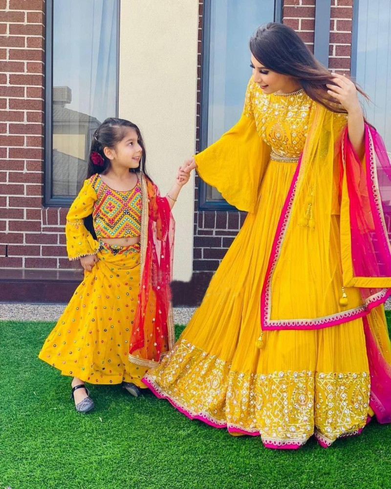 Mother And Daughter Matching Yellow Color Party Wear Lehenga Choli