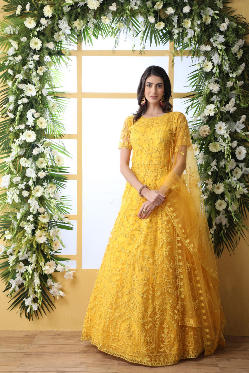 Trendy Party Wear YellowNet With Embroidered Work Designer Gown