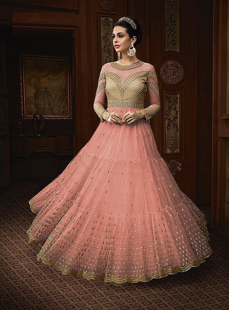 Flattering Peach Colour Net With Embroidereded Festival Wear Gown