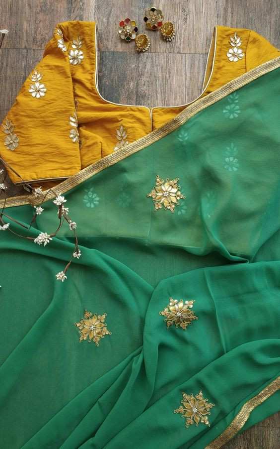 Stylish Dark Green Color Georgette Party Wear Saree ​​​​​​​