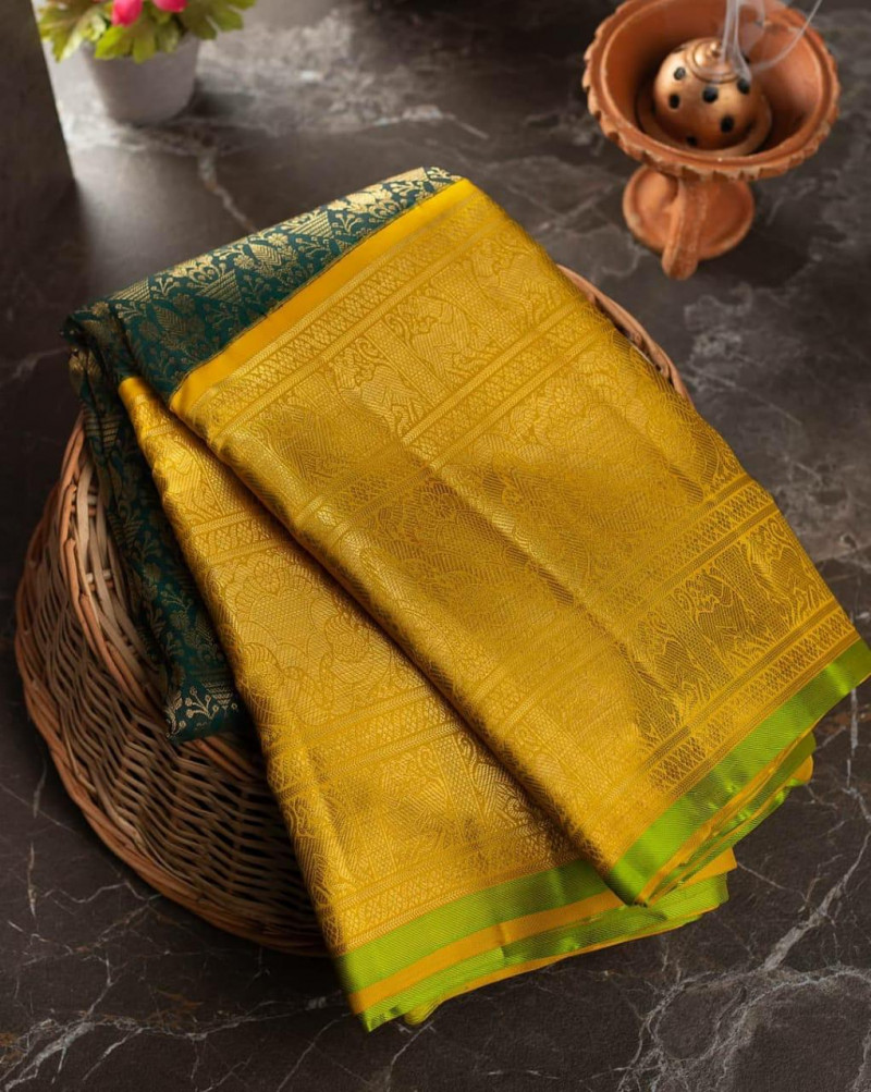 Exclusive Yellow Soft Lichi Silk Festival Wear Saree With Contrast Blouse