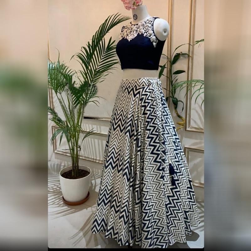 Latest Party Wear White Colored Lehenga With Blue Choli