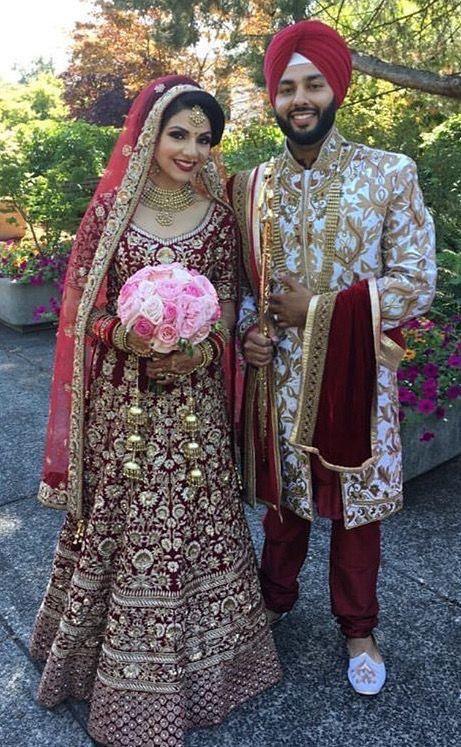 Maroon velvet heavy embroidered designer bridal lehenga