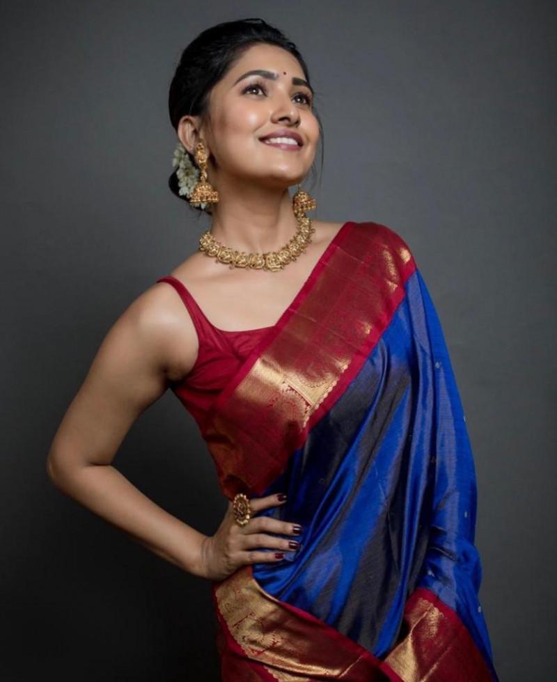 Sparkling Royal Blue Kanjivaram Lichi silk Saree With Contrast Blouse