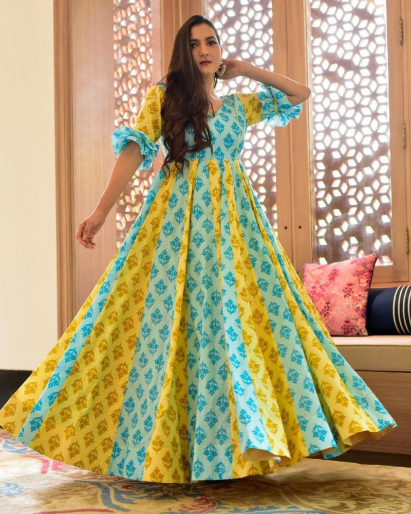 Ravishing Yellow And Sky Blue Long Gown For Girls