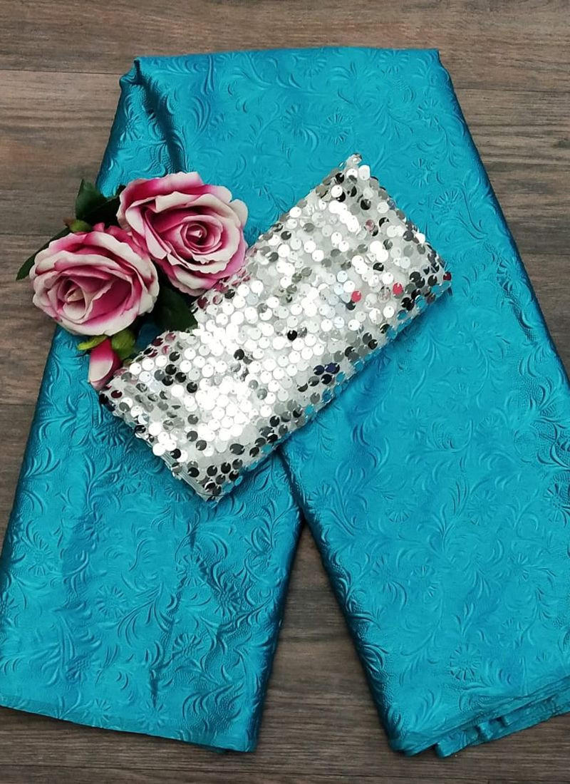 Sky Blue Emboss Satin Saree with Silver Sequin Blouse