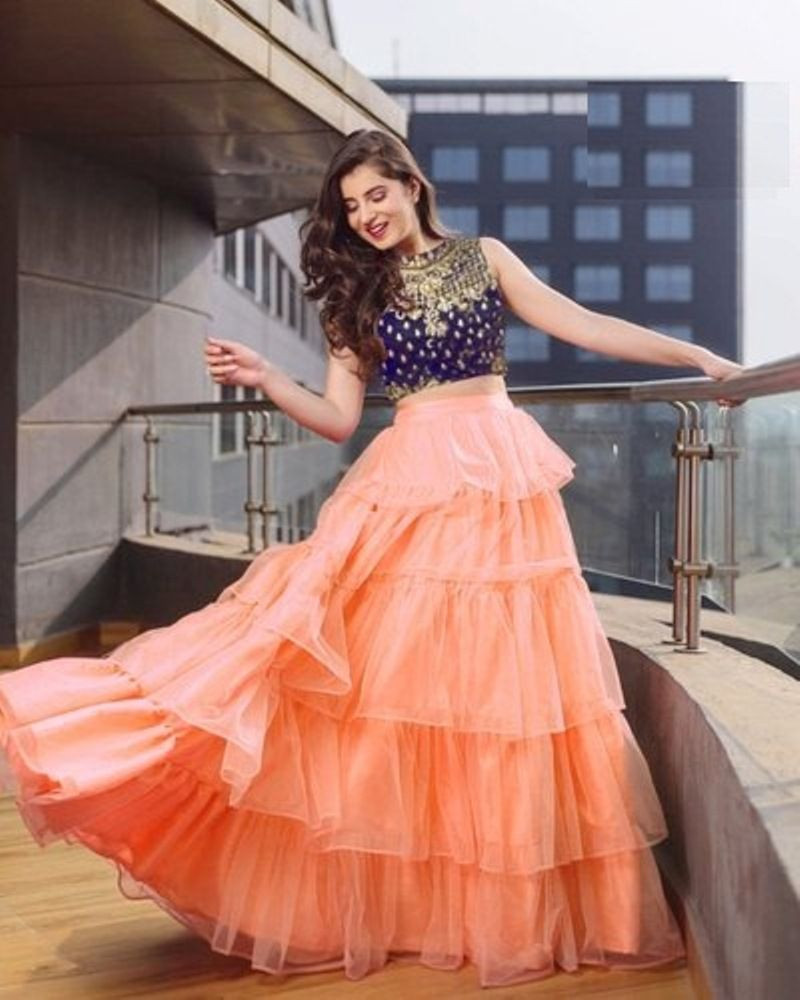 Latest Designer Embroidered Ladies Orange Net Lehenga
