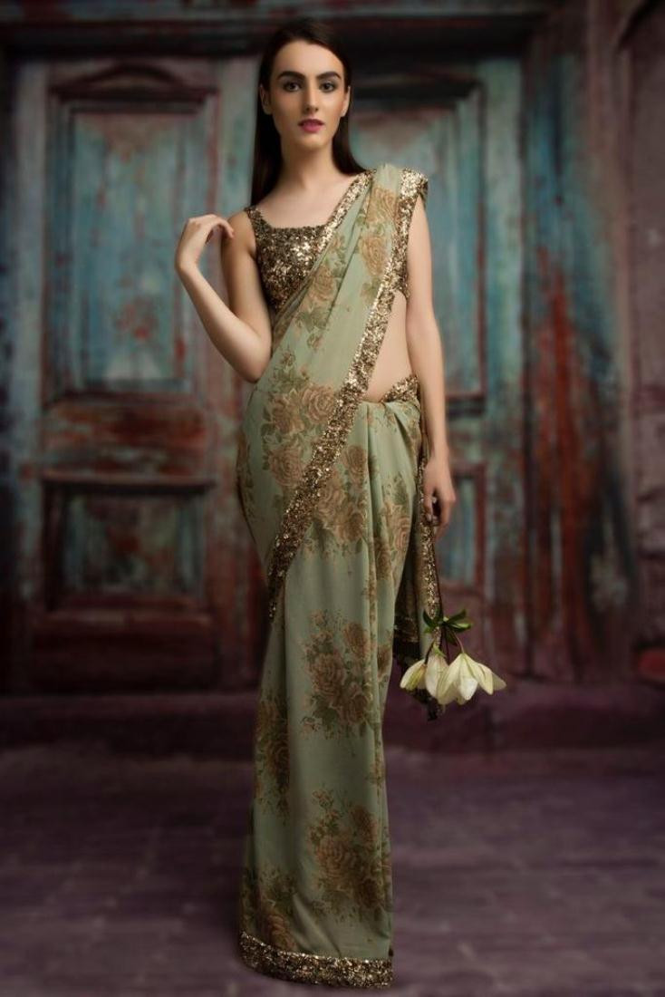 Buy Sabyasachi Light Green Georgette Floral Printed Saree Online from YOYO Fashion