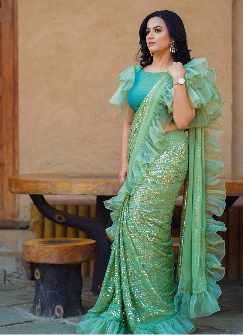 Traditional wear Light Green Georgette Embroidered Clara Saree