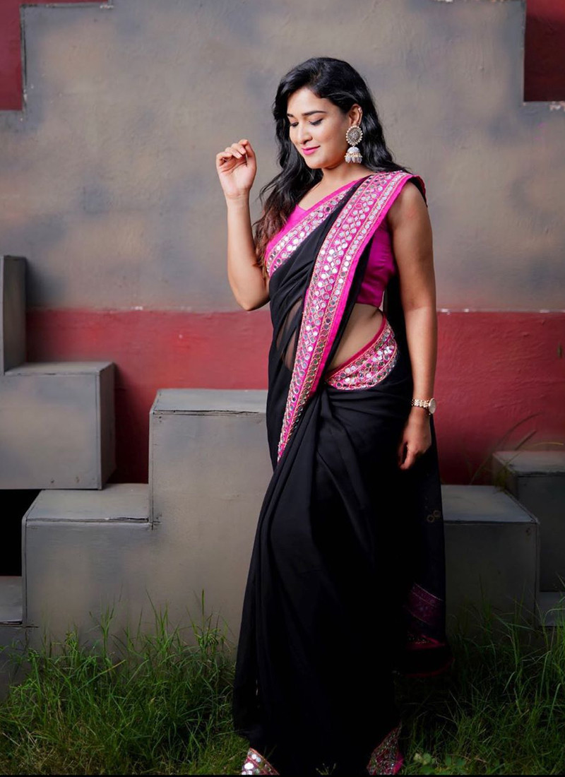 Simple Black Georgette Saree with Pink Lace