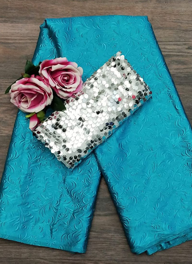 heavenly-sky-blue-emboss-satin-silk-saree-with-sequin-blouse