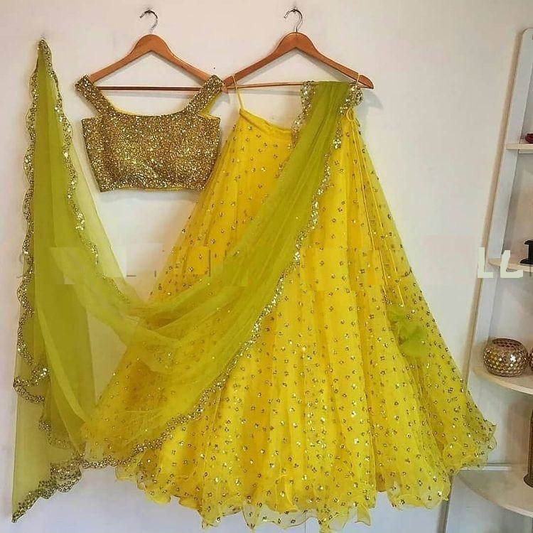 Yellow Wedding Wear Net Lehenga Choli